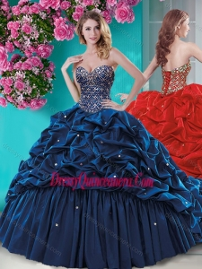 Traditional Beaded and Ruffled Quinceanera Dress with Brush Train