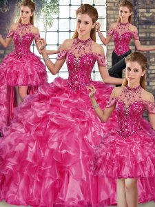 Spectacular Fuchsia Halter Top Neckline Beading and Ruffles Quince Ball Gowns Sleeveless Lace Up