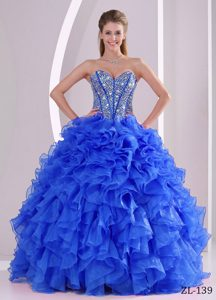 Elegant Sweetheart Beaded Blue Organza Quinceaneras Dress with Ruffles