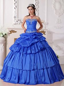 Appliqued and Ruched Blue Sweet 16 Dresses with Layers and Pick-ups in Taffeta
