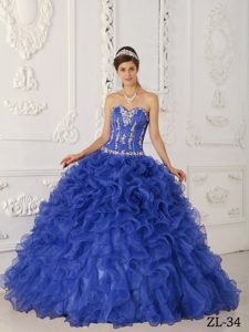 Purple Satin and Organza Quinceanera Dress with Appliques and Ruffled Layer